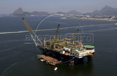 The Petrobras P-40 platform undergoes maintenance as it floats in the Guanabara Bay of Rio de Janeiro.(Douglas Engle/Australfoto)