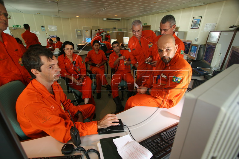 Engineers in the control room of the Petrobras P-43 Platform ship in the Campos Basin, of the Atlantic Ocean, off the coast of Rio de Janeiro, June 1, 2006. The platform has a capacity of producing 150,000 barrels of oil per day and has even surpassed the limit when it produced 188,836 barrels in Feb. 2006. (Douglas Engle/Australfoto)