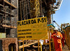 Rig workers walk past on the Petroleo Brasileiro SA P-51 oil platform at the Keppel-Fels Shipyard in Angra dos Reis, Rio de Janeiro in Brazil, on Thursday, Aug. 21, 2008. Construction of the Petrobras P51 platform, billed as the largest in the world, in Angra dos Reis, about 2 hours west of Rio de Janeio, Brazil. The platform is a landmark for Brazilian naval construction - it is the first semi-submersible built entirely in the country and will have 70% Brazilian components when finished. The P51, the P52, which is already operating, and the future P56 all come from the same basic design and have given new life to the once dormant shipyard. As the price of oil continues to rise and Brazil strikes more and more extremely deep offshore oil, workers hope to keep their jobs for many years to come. (Austral Foto/Renzo Gostoli)