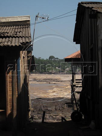 A view of the village of Cachoeira Teotonio, at the Teotonio rapids in the Madeira River near Porto Velho in Brazil's western Amazonian state of Rondonia. The rapids will disappear when the 7.7 billion dollar Santo Antonio dam goes into operation in 2011. Proponents say that Brazil needs more energy to grow and that the energy output per square kilometer of flooded area is one of the best ever. Detractors complain that fish stocks and indigenous populations will suffer.The dam will go online in December 2011 and make the Madeira River navegable for the first time - giving Bolivia access to the Atlantic ocean.  (Australfoto/Douglas Engle)