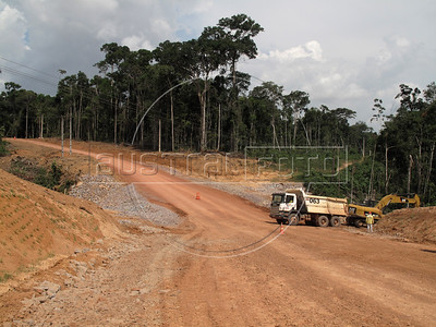 Construction of the Santo Antonio dam near Porto Velho in Brazil's western Amazonian state of Rondonia. The 7.7 billion dollar dam on the Madeira River is the center of a new round of the age-old question of environment versus development. Proponents say tha Brazil needs more energy to grow and that the energy output per square kilometer of flooded area is one of the best ever. Detractors complain that fish stocks and indigenous populations will suffer.The dam will go online in December 2011 and make the Madeira River navegable for the first time - giving Bolivia access to the Atlantic ocean.  (Australfoto/Douglas Engle)