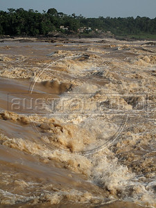 A view of the Teotonio rapids in the Madeira River near Porto Velho in Brazil's western Amazonian state of Rondonia. The rapids will disappear when the 7.7 billion dollar Santo Antonio dam goes into operation in 2011. Proponents say that Brazil needs more energy to grow and that the energy output per square kilometer of flooded area is one of the best ever. Detractors complain that fish stocks and indigenous populations will suffer.The dam will go online in December 2011 and make the Madeira River navegable for the first time - giving Bolivia access to the Atlantic ocean.  (Australfoto/Douglas Engle)