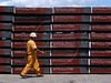 "A worker walks past semi-finished steel slabs await export at the Companhia Siderurgica de Tubar‹o (CST) in Serra, an industrial suburb of Vitoria in Brazil's Espirito Santo state, Tuesday, March 11, 2003. CST makes semi-finished steel (slabs) for export and hold about 20 percent of the world market share. The Company, which began operations in 1983 and was privatized in 1992, also recently inaugurated a ""hot strip"" mill as well for the domestic market. California Steel Industries is one of the partners along with Brazilian and Japanese investors. 49 percent of their slab exports go to North America while 23 percent go to Europe, 21 percent to Asia and seven percent to South America. With low production costs and huge reserves of iron ore, Brazil replaced Mexico as the number 2 US steel supplier in 2002, after Canada.(Australfoto/Douglas Engle)"