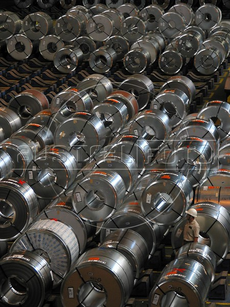 A worker inspects finished steel coils at the Companhia Siderurgica Nacional (CSN) in Volta Redonda, in the state of Rio de Janeiro, Brazil, Thursday, March 13, 2003. CSN, which began operations in 1946 and privatized in 1993, is Brazil's oldest integrated steel producer in Brazil and boasts being the largest in Latin America. The establishment of CSN paved the way for Brazil's current industrialization. It is the only tin-plate producer in Brazil. With low production costs and huge reserves of iron ore, Brazil replaced Mexico as the number 2 US steel supplier in 2002, after Canada. (Australfoto/Douglas Engle)