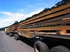 "A double-length truck carries semi-finished steel slabs to a nearby port at the Companhia Siderurgica de Tubar‹o (CST) in Serra, an industrial suburb of Vitoria in Brazil's Espirito Santo state, Tuesday, March 11, 2003. CST makes the semi-finished steel slabs for export and hold about 20 percent of the world market share. The company, which began operations in 1983 and was privatized in 1992, also recently inaugurated a ""hot strip"" mill as well for the domestic market. California Steel Industries is one of the partners along with Brazilian and Japanese investors. 49 percent of their slab exports go to North America while 23 percent go to Europe, 21 percent to Asia and seven percent to South America. With low production costs and huge reserves of iron ore, Brazil replaced Mexico as the number 2 US steel supplier in 2002, after Canada. (Australfoto/Douglas Engle)"
