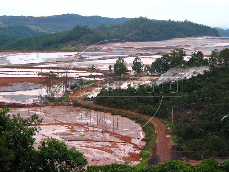 A depleted iron-ore mine of the Companhia do Vale do rio Doce (CVRD) undergoes environmental recuperation in the Brazilian state of Minas Gerais. CVRD, one of the largest mining companies in the world,  operates two integrated systems in Brazil for producing and distributing iron ore, each consisting of mines, railroads and port and terminal facilities. The Southern System is based in the states of Minas Gerais and Espirito Santo and the Northern System is based in the states of Para and Maranhao. (Douglas Engle/Australfoto)