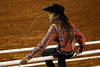 "A cowgirl sits on the rail of the rodeo stadium at the Rodeo in Barretos, Sao Paulo state, Brazil. Held at the end of August it's the largest and best known rodeo in Brazil, with bull riding, barrel racing, calf roping, bareback riding, team roping, bulldogging, and more. The event started in 1955 under a simple circus tent and has now grown to mega-proportions, drawing visitors and participants from around the world. The 1.3 million square meter rodeo grounds, the ""Parque do Peao"", (Cowboy Park) has a parking capacity for over 14 thousand cars and includes a special horseshoe-shaped rodeo stadium. The Barretos Rodeo is on the World Rodeo Circuit Calendar. (Australfoto/Douglas Engle)"