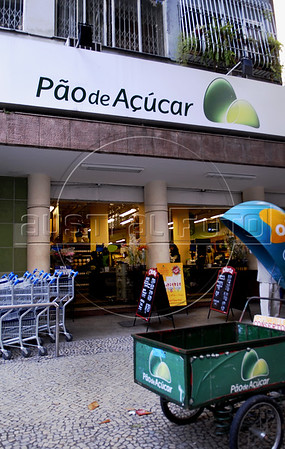 A signage of Pao de Acucar supermarket is displayed outside of Flamengo district, Rio De Janeiro, Brazil, June 29, 2011. The proposed merger of french  Carrefour SA with Cia. Brasileira de Distribuicao Grupo Pao de Acucar SA would be reviewed by local regulators together with other recent acquisitions by Pao de Acucar, the president of the antitrust agency said. (Austral Foto/Renzo Gostoli)
