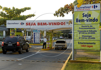 A signage of Carrefour supermarket is displayed in front of a store in Barra da Tijuca neighborhood, Rio De Janeiro, Brazil, June 30, 2011. The proposed merger of french Carrefour SA with Cia. Brasileira de Distribuicao Grupo Pao de Acucar SA would be reviewed by local regulators together with other recent acquisitions by Pao de Acucar, the president of the antitrust agency said. (Austral Foto/Renzo Gostoli)