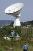 A woman walks near a massive satelite antenna of Embratel, the long distance carrier formerly owned by WorldCom, in Tambau, about 40 miles east of Rio de Janeiro, Brazil. Embratel is Brazil's dominant long-distance carrier and handles the bulk of the nation's Internet traffic. (Douglas Engle/Australfoto)