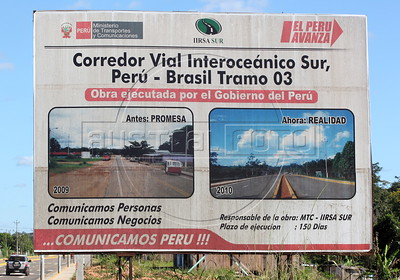 A sign in Inapari, in the Peruvian Amazon, announces the completion of a segment of the Transoceanic Highway. Financed in part by Brazil, and built by a consortium which includes Brazilian construction company Oderbrecht, the US$1.3 billion highway will link Peru's Pacific ports, and thus China, with the regional powerhouse of Brazil, poised to become the 5th largest economy in the world. (Australfoto/Douglas Engle)