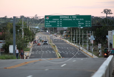 A view of the Inapari, Peru, from the international bridge where the Transoceanic Highway crosses into the country from Brazil. passes. Financed in part by Brazil, and built by a consortium which includes Brazilian construction company Oderbrecht, the US$1.3 billion highway will link Peru's Pacific ports, and thus China, with the regional powerhouse of Brazil, poised to become the 5th largest economy in the world. (Australfoto/Douglas Engle)