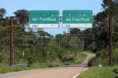 The Transoceanic Highway in Brazil's Amazonian state of Acre, which borders Peru. Financed in part by Brazil, and built by a consortium which includes Brazilian construction company Oderbrecht, the US$1.3 billion highway will link Peru's Pacific ports, and thus China, with the regional powerhouse of Brazil, poised to become the 5th largest economy in the world. (Australfoto/Douglas Engle)