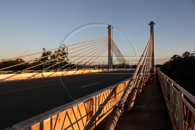 A view of the international bridge across the Acre River, which separates Peru from Brazil, and where the Transoceanic Highway passes. Financed in part by Brazil, and built by a consortium which includes Brazilian construction company Oderbrecht, the US$1.3 billion highway will link Peru's Pacific ports, and thus China, with the regional powerhouse of Brazil, poised to become the 5th largest economy in the world. (Australfoto/Douglas Engle)