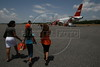 Passengers walk to a TAM Airlines jet at the Manaus airport, Sept. 9, 2005.(Australfoto/Douglas Engle)