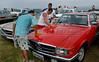 Collectors prepare a Mercedes Benz 280 coupe at Forte de Copacabana (Copacabana Fort) in Copacabana beach, during a annual exhibition of the Veteran Car Club do Brasil, Rio de Janeiro, Brazil, Set. 6, 2009. About 200 old cars participates at this annual meeting. (AustralFoto/Renzo Gostoli)
