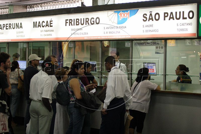 Customers line up to buy tickets at the Rio de Janeiro, Brazil, bus station, Aug. 2, 2007.Two major air crashes in less than 11 months, killing some 350 people, have highlighted problems long ignored in Brazil's aviation industry. While some Brazilians shrug off the problems, others simply head for the bus station rather than face long delays, sometimes longer than a bus journey, at airports. Bus stations and operators welcome the increase in passengers and hope it will stay that way by offering luxury and executive class service which offer more amenities than bargain airlines. Traveling by highway is also dangerous - over 600 people were killed on federal highways in July 2007 alone. (Australfoto/Douglas Engle)