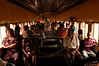 """Passengers on the Trem Metropolitano de Maceio (Maceio Metropolitan Train), in Maceio, Alagoas state, Brazil. Originally founded in 1884 as the """"Alagoas Railway"""" by an Englishman, The 32 km line is now operated by the Companhia Brasileria de Trens Urbanos (CBTU) and runs from Macei— to the town of Loureno de Albuquerque. Eight trains make the 1 hour trip, each direction, daily. The trip currently costs 50 Brazilian cents (about 25 US cents) and is a lifeline for residents of the simple bedroom communities along it. It also make for a good tourism alternative in the region, since the line passes by some of the lagoons which give the state its name. The CBTU operated all urban trains in Brazil until several were sold off or given operating concessions in the 1990s.(Australfoto/Douglas Engle)"""