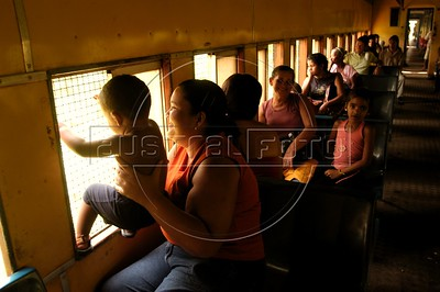 "Passengers on the Trem Metropolitano de Maceio (Maceio Metropolitan Train), in Maceio, Alagoas state, Brazil. Originally founded in 1884 as the ""Alagoas Railway"" by an Englishman, The 32 km line is now operated by the Companhia Brasileria de Trens Urbanos (CBTU) and runs from Macei— to the town of Loureno de Albuquerque. Eight trains make the 1 hour trip, each direction, daily. The trip currently costs 50 Brazilian cents (about 25 US cents) and is a lifeline for residents of the simple bedroom communities along it. It also make for a good tourism alternative in the region, since the line passes by some of the lagoons which give the state its name. The CBTU operated all urban trains in Brazil until several were sold off or given operating concessions in the 1990s.(Australfoto/Douglas Engle)"