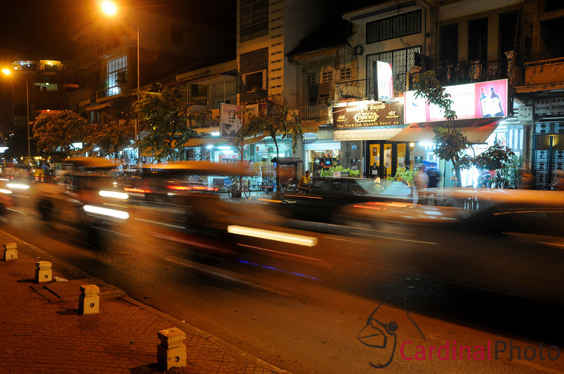 River Road at Night, Motion blur showing local tuk-tuks and other street life. Phnom Penh, Cambodia, Southeast Asia.