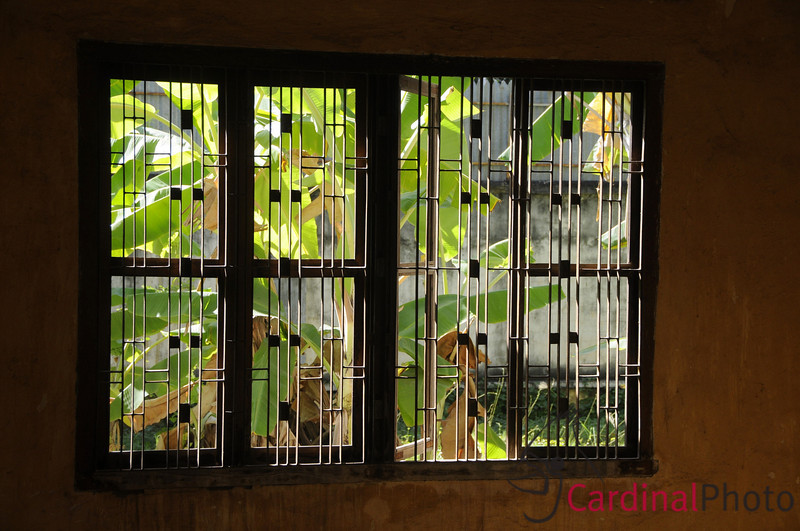 Tuol Sleng (also known as S21) a detention, torture center and prison of the Khmer Rouge, showing a barred window in one of the cells, in Phnom Penh, Cambodia, Southeast Asia