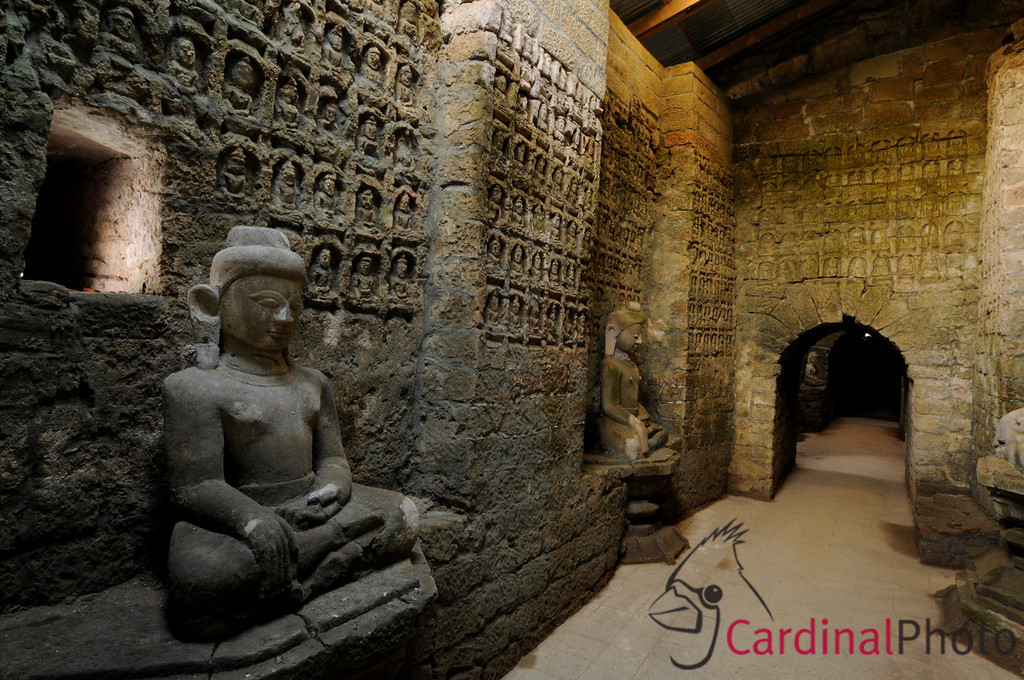 Outer Crypt at Koe Thaung Temple showing some of the many thousands of Buddha carvings in the wall and some of the many Buddha statues sunlight near Mrauk U, Rakhine Division, Arakhan Kingdom, Myanmar (Burma), Southeast Asia