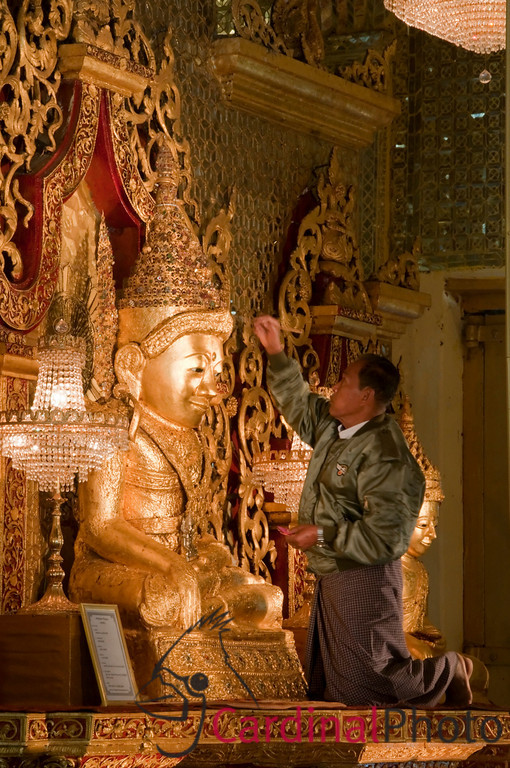 Member of the ruling military offers gold as gilding, as traditional for the Buddhist relition, to the replacement Mahamuni Buddha north of Mrauk U, Rakhine Division, Arakhan Kingdom, Myanmar (Burma), Southeast Asia