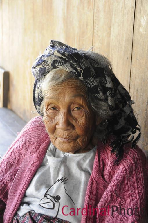 Shan Tribal Elder Woman Grandmother at her house in a Shan Village near Kalaw, Shan State near Heho, Myanmar, Burma, Southeast Asia