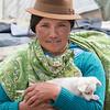 Indigenous woman and puppy, Zumbahua, Ecuador.