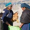 Women and bag of chickens, Otavalo, Ecuador