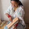 Woman carding wool, Imbabura, Ecuador
