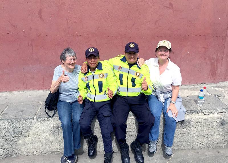 12/1/15 - Climbing the stairs to Turi with Jim and Kara Shea. Susan and Kara Shea with two police at the top.