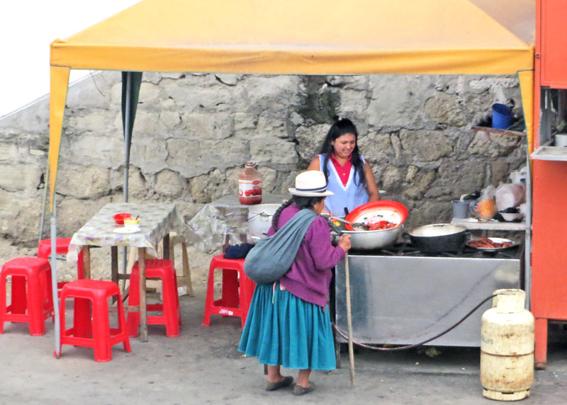We took a bus tour of Cuenca today.   Indigenous woman at eatery up at Turi.