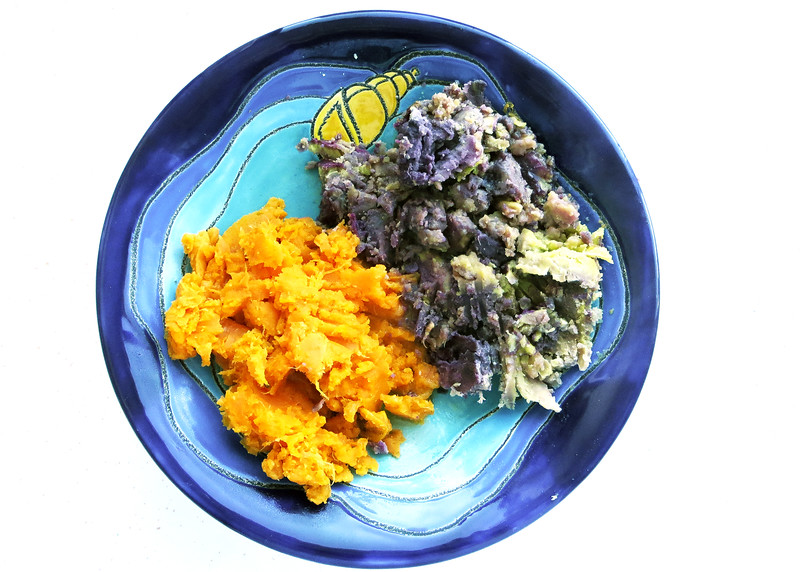 7/14/15 - Our regular orange sweet potato and a purple potato.  My dinner, I wanted to try them side by side.  The purple one tasted very much like a regular potato, just a very different color.