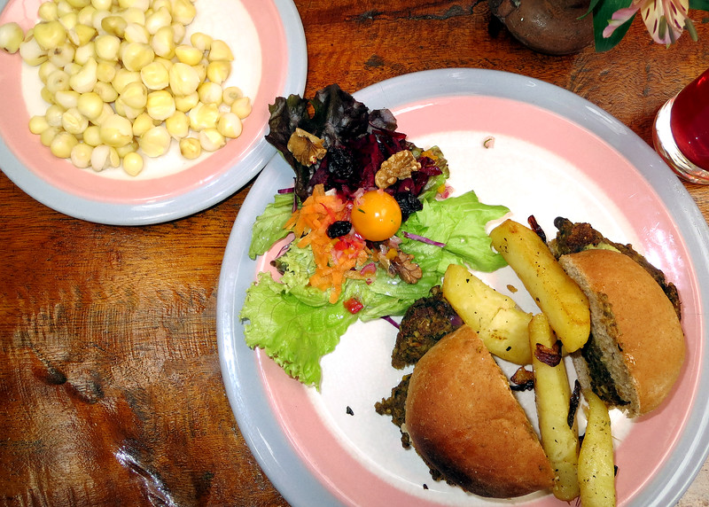 """6/28/15 - We attended a """"Lunch and Learn"""" at Quinoa Restaurant were we learned about cooking with the fresh fruits and vegetables here.  This is part of the lunch; hominy, black bean burger, salad and what isn't showing is the fig in panela (brown sugar) sauce.  Soooo good!!"""