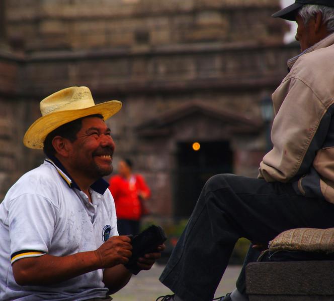 "An Ecuadorian man with an ear to ear grin shining shoes in Quito, Ecuador.  Travel photo from Quito, Ecuador. <a href=""http://nomadicsamuel.com"">http://nomadicsamuel.com</a>"