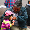"A child eats ice cream while a proud guardian wipes her mouth - Quito, Ecuador.  This is a travel photo from Quito, Ecuador. <a href=""http://nomadicsamuel.com"">http://nomadicsamuel.com</a>"