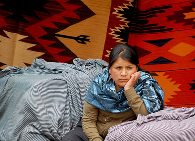A Young Woman Waiting For Customer, Otavalo Ecuador.