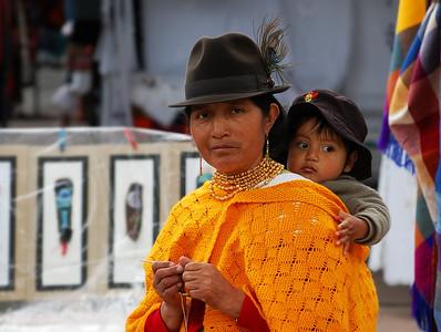 Ecuadorian lady and her child, Otavalo Market Ecuador.