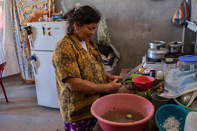 A woman prepares the afternoon meal in Anconcito, Ecuador.