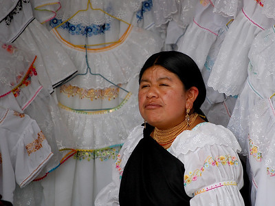 Otovala Lady In Front of Native Dresses.