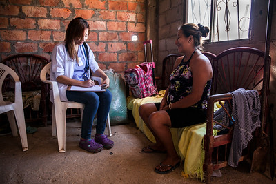 Dr. Melba consults with a woman during a house call for high risk pregnancies.