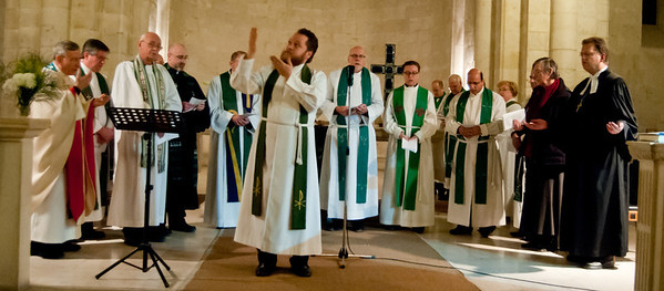 Rev. Janne Rissanen (Evangelical Lutheran Church of Finland) leads the worshipping assembly in the Lord's Prayer with sign language during the service marking day four of the Week of Prayer for Christian Unity at the Evangelical Lutheran Church of the Redeemer in the Old City of Jerusalem. Photo © ELCJHL/Rev. Elizabeth McHan