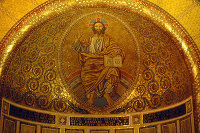 Just above the altar in the Lutheran Church of Christ, Rome, is a brightly colored mosaic of Jesus Christ.