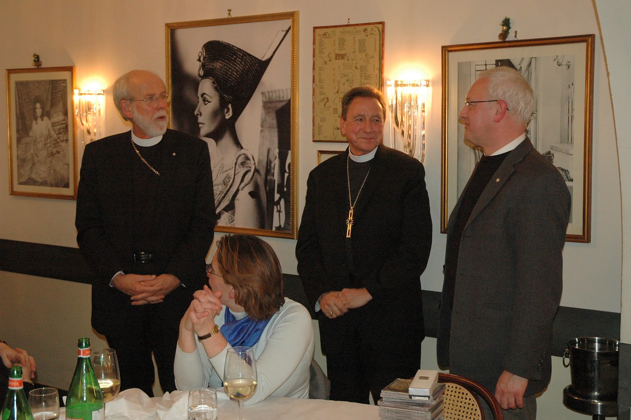 Dean Holger Milkau, right, Evangelical Lutheran Church in Italy, hosted the ELCA delegation at a dinner Feb. 10.  With him are, left, ELCA Presiding Bishop and LWF President Mark Hanson and the Rev. Donald McCoid, center, executive for ELCA Ecumenical and Inter-Religious Relations.