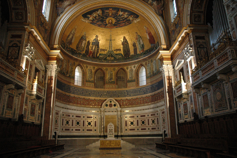 This the altar area of a Roman basilica.  Most of the art surrounding the altar is a mosaic.