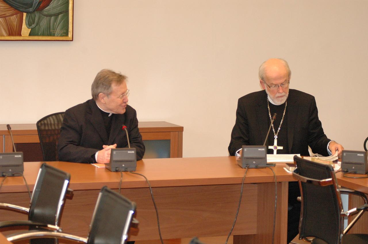 Cardinal Walter Kasper, left, president, Pontifical Council for Promoting Christian Unity, addresses ELCA Presiding Bishop and LWF President Mark Hanson Feb. 12 in Rome.