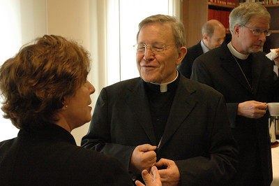 Cardinal Water Kasper, right, talks with Bishop Claire Burkat, ELCA Southeastern Pennsylvania Synod, during a break in the Feb. 12 meeting in Rome.