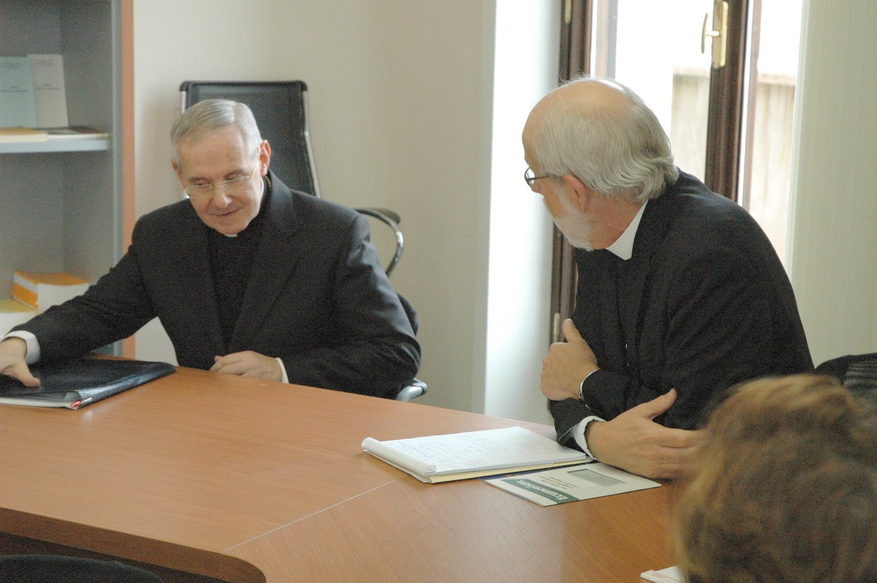 Cardinal Jean-Louis Pierre Tauran, president, Pontifical Council for Interreligious Dialogue, left, listens as ELCA Presiding Bishop and LWF President Mark Hanson speaks during the ELCA delegation's meeting with Tauran Feb. 12 in Rome.