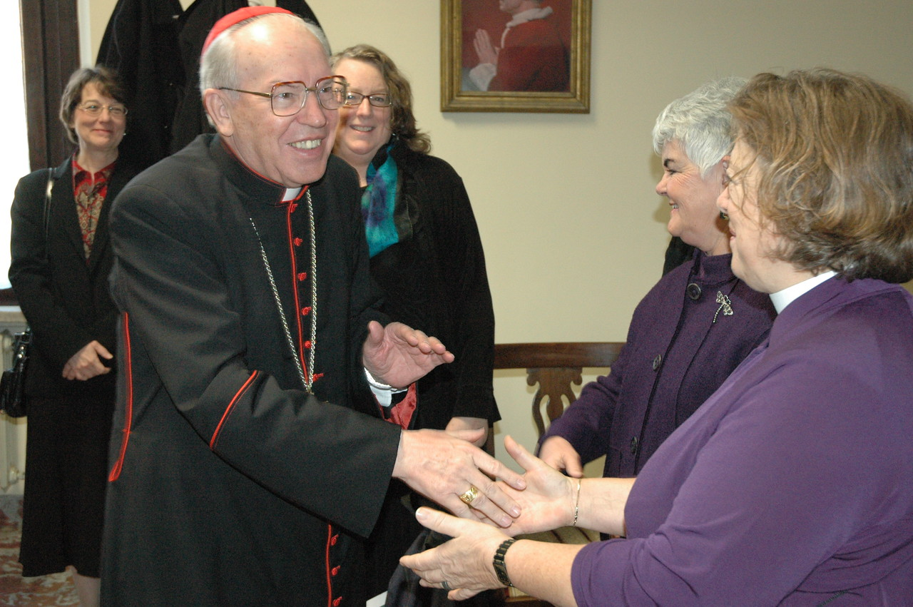Cardinal Giovanni Battista Re, prefect of the Congregation for Bishops, The Vatican, greets the Rev. Susan Langhauser, Olathe, Kan., ELCA Church Council member, and other members of the ELCA delegation Feb. 13 in Rome.